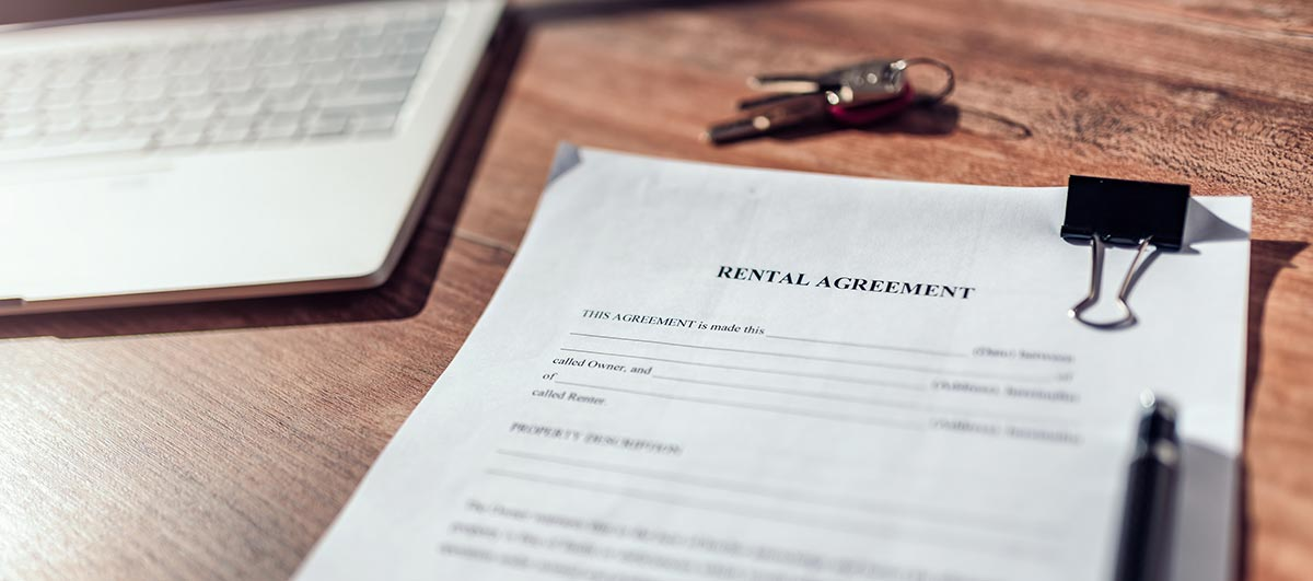 how to improve tenant retention - rental agreement on a table