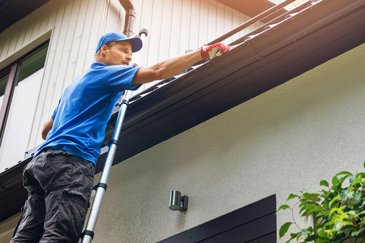 man-cleaning-gutters